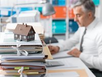 real-estate-mortgage-loans-and-paperwork-PXTTACG.jpg