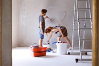 couple-painting-hearts-on-the-wall-in-their-house-PBL8SFU.jpg